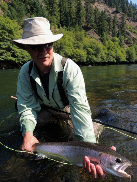 Doug Eisenberg admiring his second steelhead in his first year of steelheading